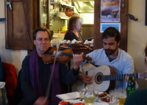 Kostantis Kourmadias (violin) and Antonis Mylonas (guitar) from the workshop I was attending playing for the restaurant owners that coordinated the village response to the refugee arrivals.
