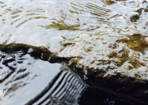 water rippling over rock